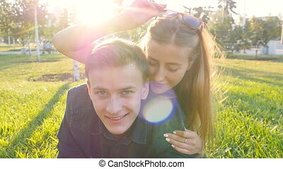 Young couple in love having fun and enjoying on grass