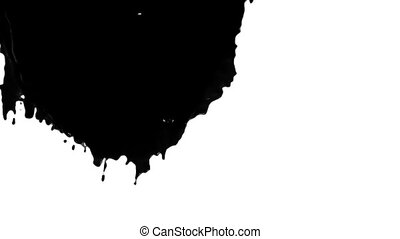 black paint flowing down in slow motion - close-up view of...