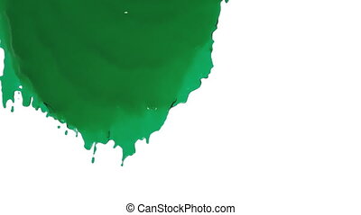 green paint flowing down in slow motion - close-up view of...