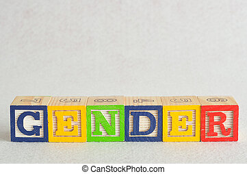 The word gender spelled with colorful alphabet blocks isolated on a white background