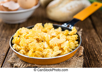 Pan with scrambled Eggs selective focus - Pan with fresh...