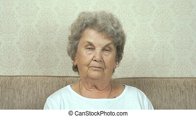 Portrait of serious senior woman with harsh look