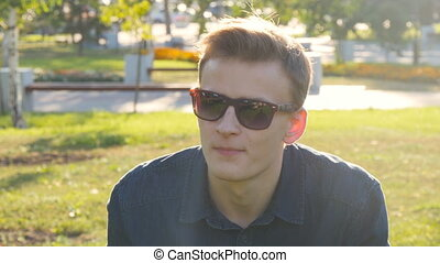 Man with sunglasses relaxing on the grass