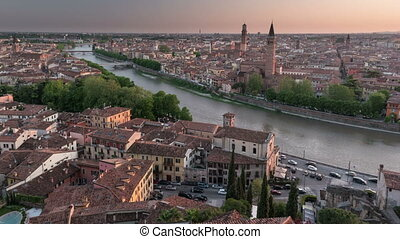 Aerial view of Verona Italy - Day to night transition...