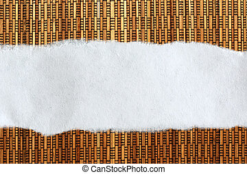 Ragged piece of paper on straw background