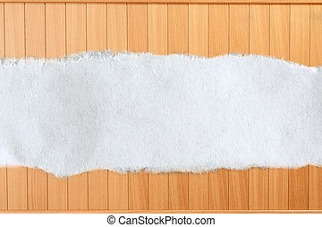 Ragged piece of paper on wooden background