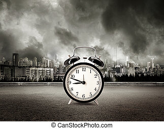 Clock on view of city in stormy sky background