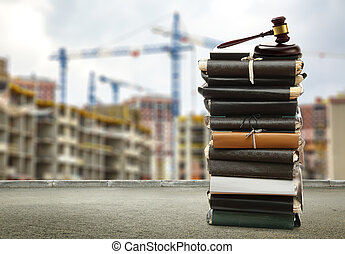 Gavel on buildings and cranes background closeup