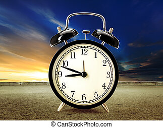 Clock at sunset sky and road background