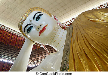 reclining buddha yangon - reclining buddha with big eye in...