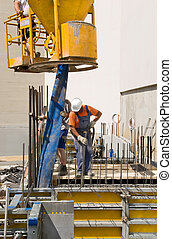 construction workers and cement mixer on a construction site