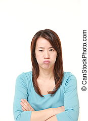 middle aged Japanese woman in a bad mood - portrait of...