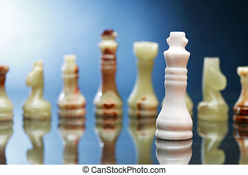Chess Pieces On Dark - Set of chess pieces made from Onyx...