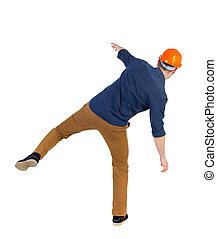 Balancing young man or dodge the falling - Balancing young...