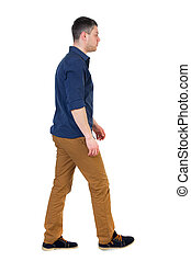 Back view of going handsome man. walking young guy . Rear...