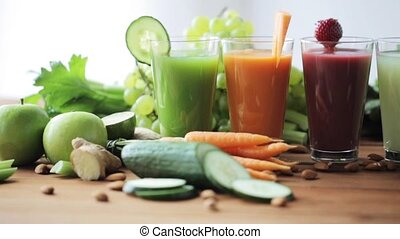 glasses of juice, vegetables and fruits on table - healthy...