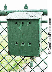 Old green metallic mailbox on the fence Mail delivery Retro...