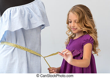 Delighted girl taking waist measurement - As an adult....