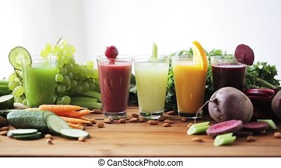 hand putting glass of vegetable juice to table - healthy...