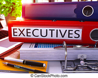 Executives on Red Ring Binder. Blurred, Toned Image. -...