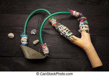 Wooden catapult slingshot - Handmade slingshot on black...