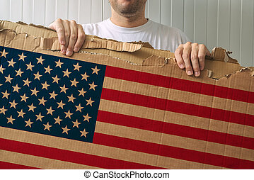Man holding cardboard with USA flag printed, adult male...
