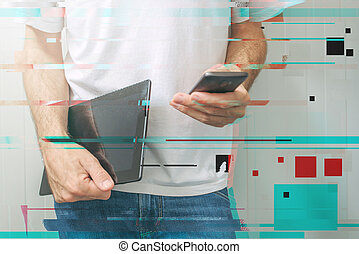Guy using smartphone and digital tablet, modern mobile...