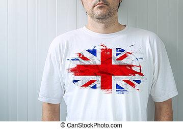 Man wearing white shirt with UK flag print - Man wearing...