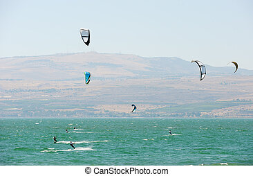 Sky-surfing on lake Kinneret - Sky-surfing in the rays of...