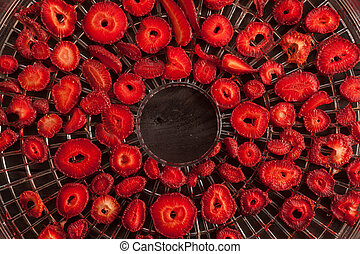 Strawberries and drier concept - Slices of strawberries on...