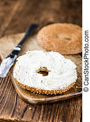 Homemade cream cheese Bagel selective focus; close-up shot
