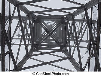 transmission tower silhouette in deep mist white background...