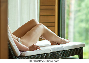 Woman relaxing in spa after massage.