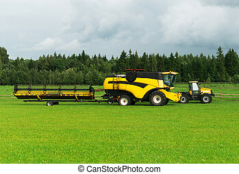 Agricultural machinery on the green field is ready for work.