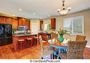 Luxury kitchen room connected with dining area.