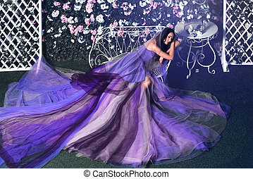 Woman in purple dress sitting on the bench - Beautiful...