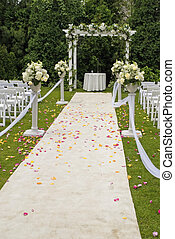 Wedding Trail - A white wedding carpet covered in rose...