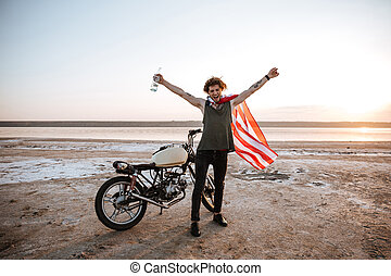 Man in american flag cape with hands up in air - Smiling...
