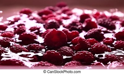Ripe raspberries and shallow water ripple, super slow motion video