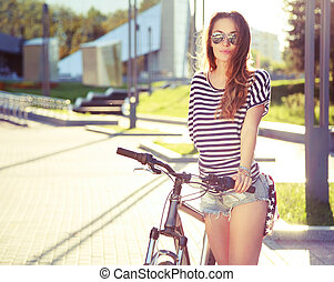 Fashion Hipster Woman with Bicycle in the City