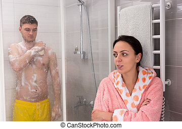 Woman waiting for her boyfriend while he rubbing himself a...