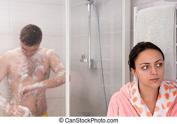 Young female waiting for her boyfriend while he rubbing...
