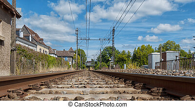 Railway track with a village in France - Railway track with...