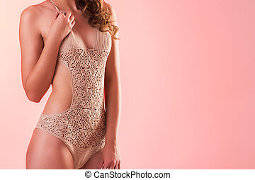 knitted bathing suit - Close up of young woman in a knitted...