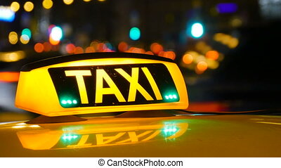 Taxi driving with motion blur and city lights.