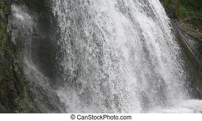 beautiful waterfall in the mountains - big waterfall in the...