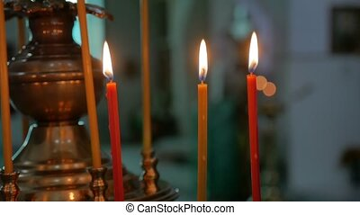 candles dark in the russian church orthodox of service sacrament indoors slow motion video