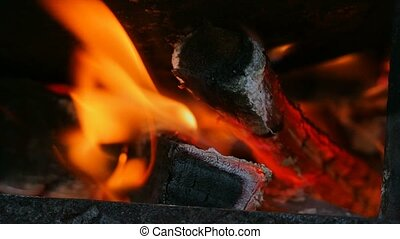 charred wood in the fire slow motion video