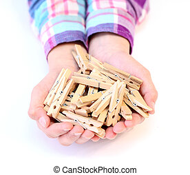clothespins - many  clothespins  in the hands of a child