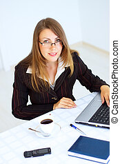 Business woman sitting at the workplace